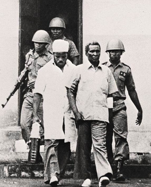 The deposed dictator, President Francisco Macias Nguema, is taken out of the courtroom in Malabo, where he was sentenced to death for high treason and genocide following a military coup in August 1979.