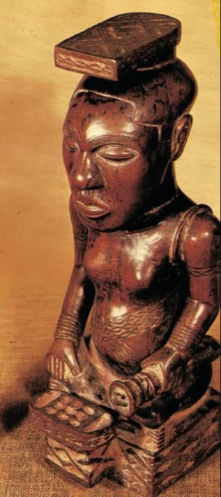 Wood sculpture to represent a cube king. 1800s.